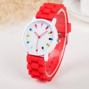 Часы с таблетками и красным браслетом